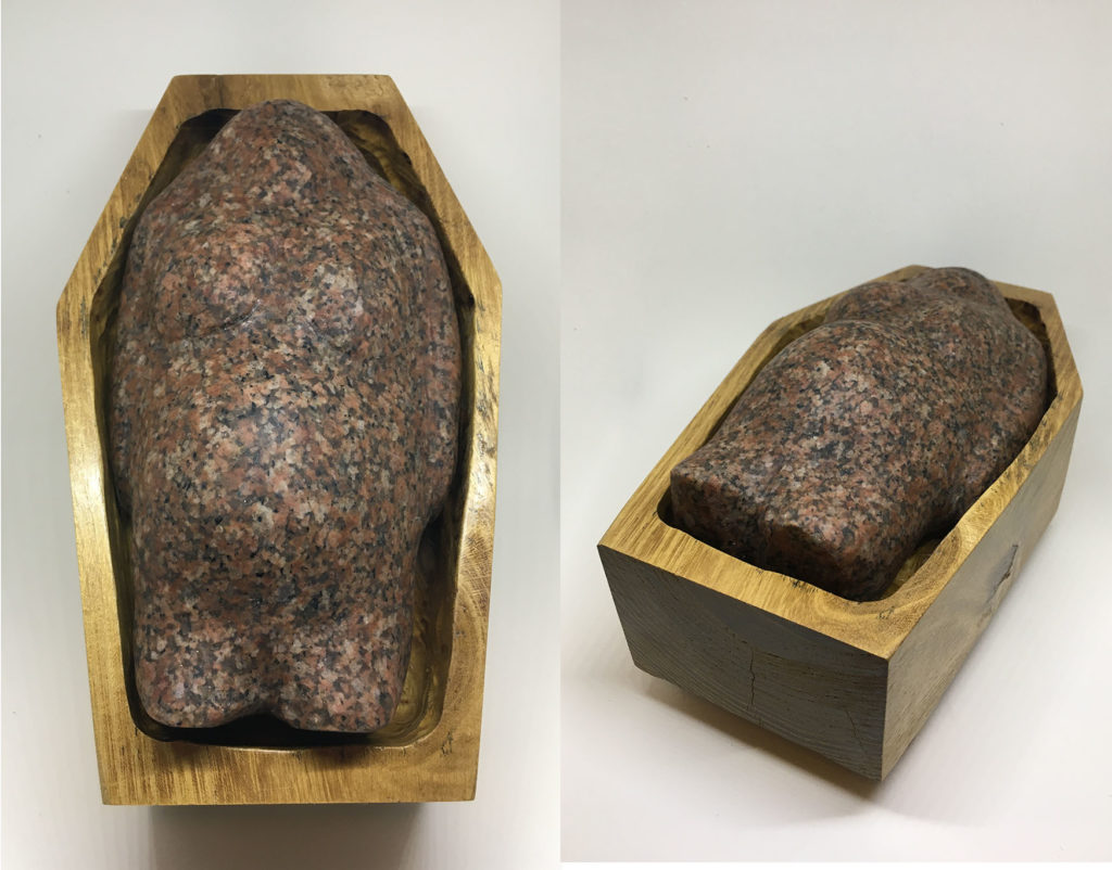 """Mother Earth in a Man Made Coffin"" granited and locust carved artwork"