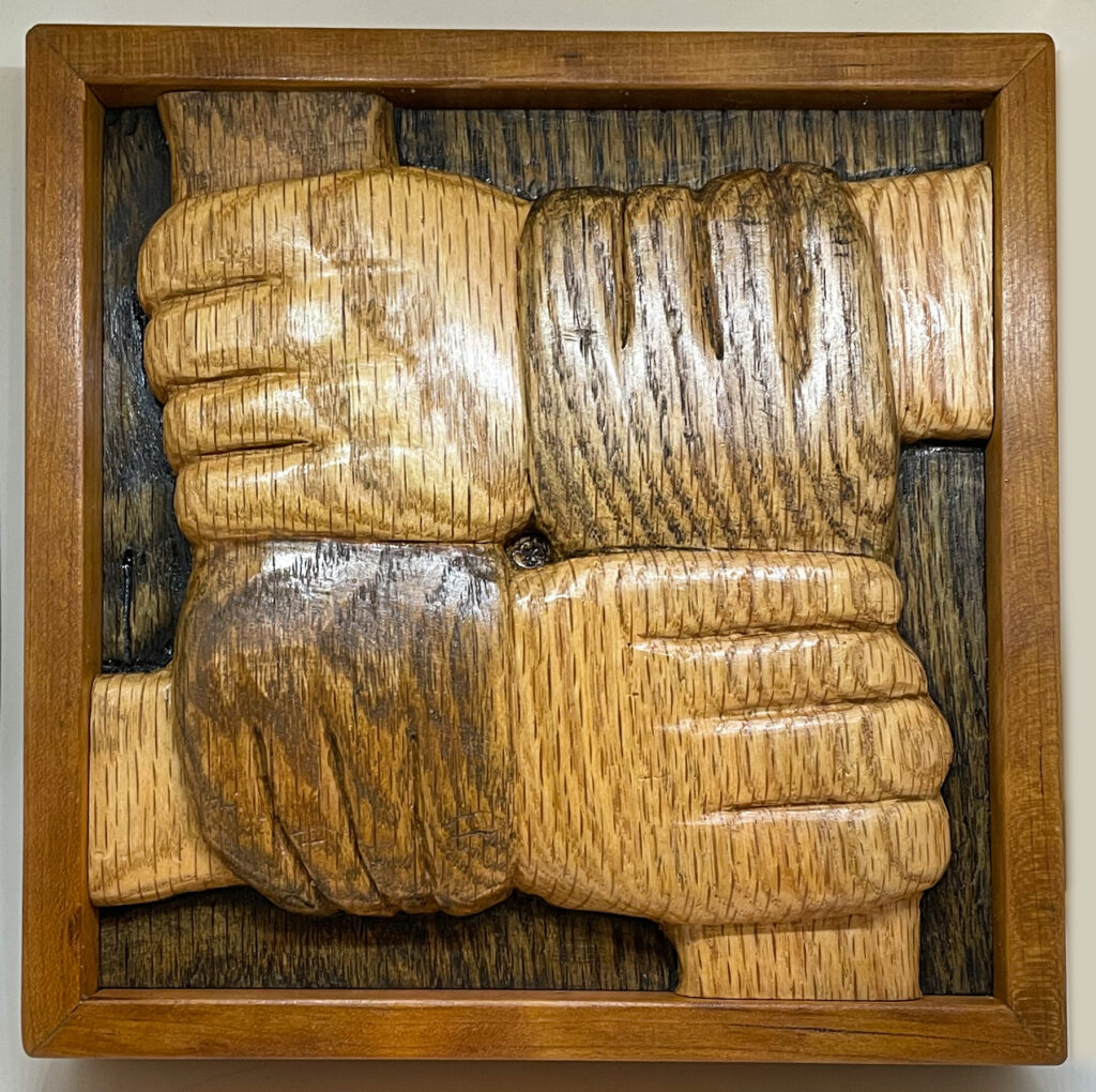 """""""Strength in Unity"""" carved wooden relief artwork"""